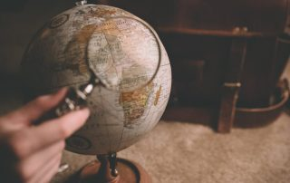 A globe with a magnifying glass